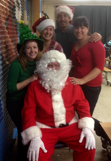 Santa and his PTA elves Jennifer Gravois, Bridget Sramek, Scott Gravois,  Jessica Drew making Tincher's youngest students' holiday dreams come true!